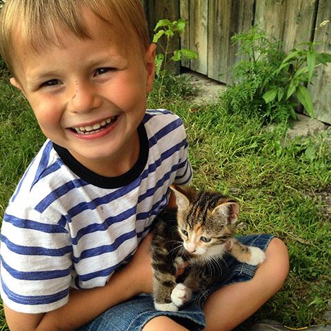 Little boy with kitten