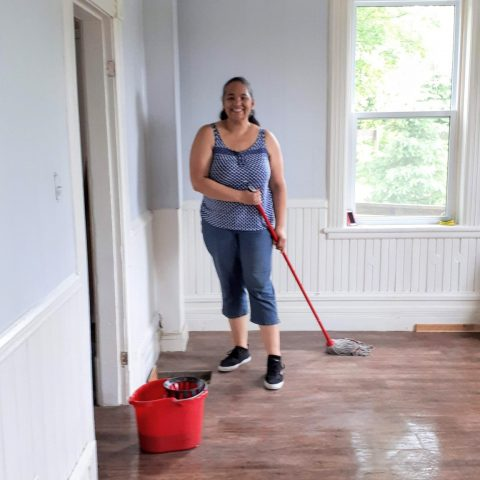 Volunteer helping with clean up